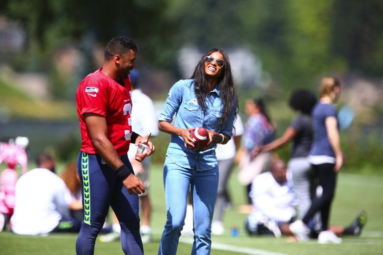 Seattle Seahawks quarterback Russell Wilson is greeted by his girlfriend, Ciara, at training camp on Thursday, August 6, 2015, at the Virginia Mason Athletic Center in Renton, Wash.  NFL FOOTBALL - SEATTLE SEAHAWKS 2015 TRAINING CAMP - VIRGINIA MASON ATHLETIC CENTER - 149078 - 080615  (John Lok / The Seattle Times)