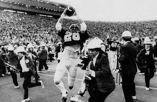 FILE--Cal's Kevin Moen (26) leaps with the ball in the air after scoring Cal's game-winning touchdown while the Stanford band runs to get out of his way in Berkeley, Calif., in this Nov. 25, 1982 file photo. Of the 101 previous games in the Stanford-Cal rivalry, 48 have been decided by a touchdown or less.  Stanford, despite having the second-worst defense in the nation, needs a win over Cal on Saturday to go to the Rose Bowl for the first time since the 1971 season.  (AP Photo/Oakland Tribune/Robert Stinnett)