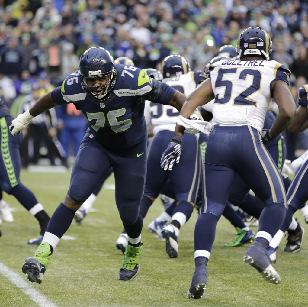 Seattle Seahawks offensive tackle Russell Okung (76) squares off against St. Louis Rams linebacker Alec Ogletree (52) in the second half of an NFL football game, Sunday, Dec. 28, 2014, in Seattle. (AP Photo/Scott Eklund)
